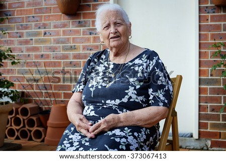 Old lady looking like she asks a question on chair in front of house bricks and  sc 1 st  Shutterstock & Old Lady Looking Like She Asks Stock Photo (Royalty Free) 373067413 ...