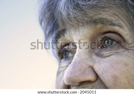 Old Lady Looking To The Sky - stock photo