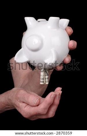 old lady plundering savings - stock photo