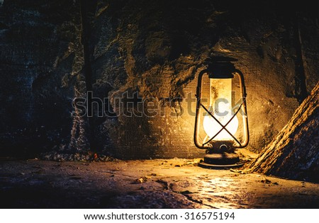 Old lamp in a mine - stock photo