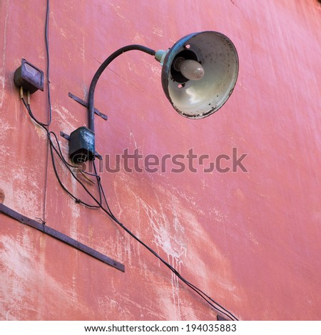 old lamp on pink wall outdoor