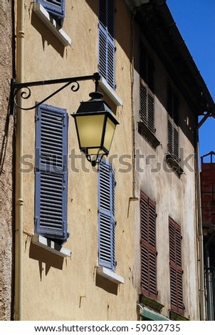 Old lamp on stone at Hyeres, provence, france - stock photo