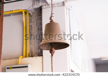 old lamp on wall .