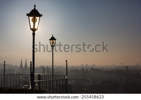 old lamp posts above city