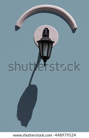 Old lamp with a shade on the wall - stock photo