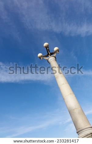 old lamppost on a background of blue sky day