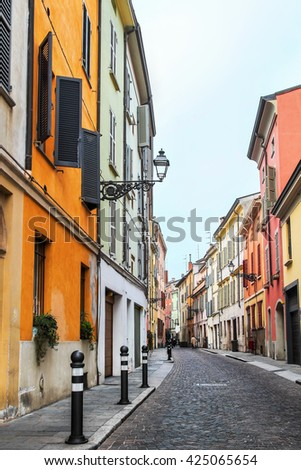 Old lane with colorful buildings in Parma, Emilia Romagna province, Italy. - stock photo