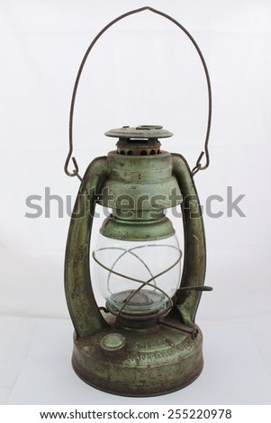 Old lantern isolated on white background. Intentional shallow depth of field, focus on foreground. Studio work. - stock photo