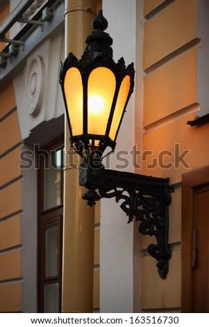 Old lantern on the wall, Saint Petersburg, Russia - stock photo