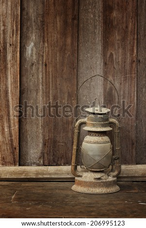 Old lantern on wooden background