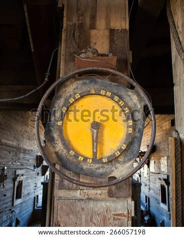 Old large industrial weigh scale in a grain elevator - stock photo