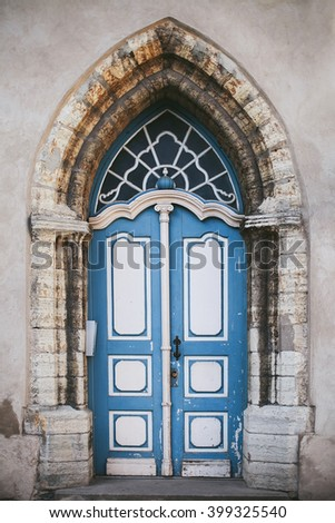 old large white and blue door in a stone doorway - stock photo