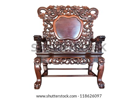 Old large wooden polished chinese chair with brown patterns, isolated in white