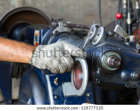Old lathe is ready to work in  the workshop - stock photo