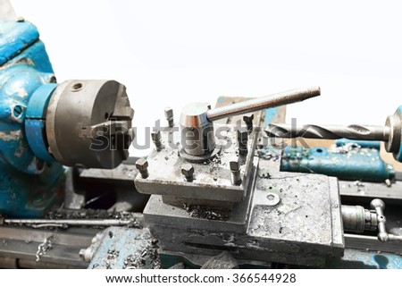 Old lathe on a white background - stock photo