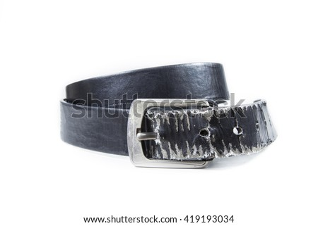 Old leather belt torn on white background - stock photo