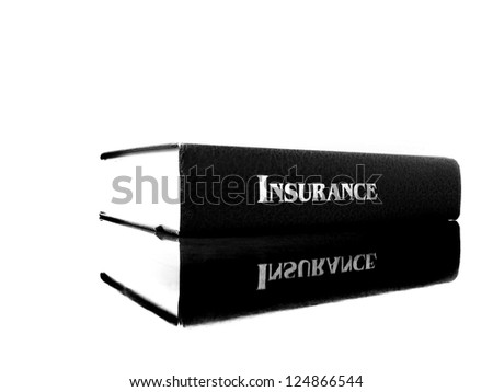 Old leather book on the topic of insurance for health care concerns in America - stock photo