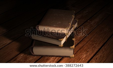 Old leather books on wooden table in candlelight
