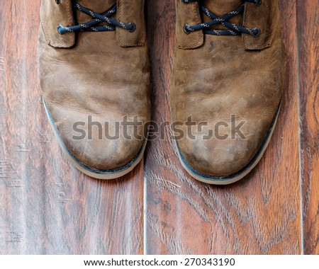 Old leather boots on a wood floor - stock photo