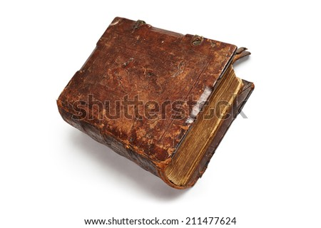 Old leather-bound book on white background - stock photo