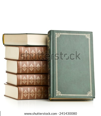 Old leather hardcover books stacked on white background - stock photo