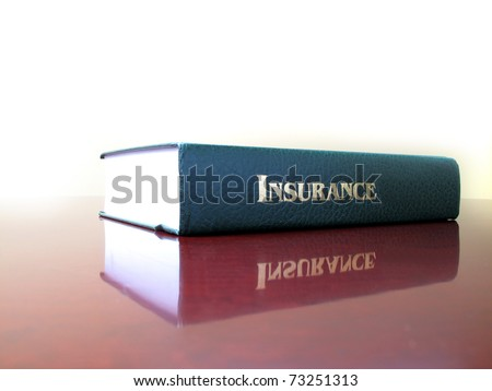 Old leather law book on the topic of insurance - stock photo