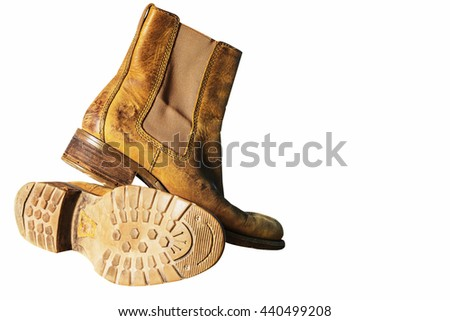 Old leather shoes on a white background