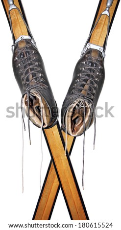 Old leather shoes on wooden skis isolated on white background  - stock photo