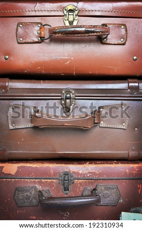 Old leather Vintage Suitcase - luggage stacked vertically - stock photo