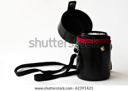 old lens case on white isolated background - stock photo