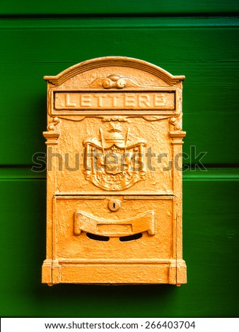 old letter box - mail box - post box on green wooden door - stock photo
