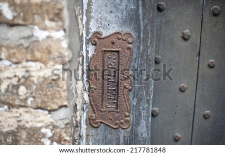 Old letter slot - stock photo