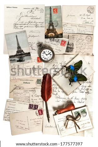 old letters, accessories and postcards. sentimental vintage travel background with antique clock, feather pen and butterfly