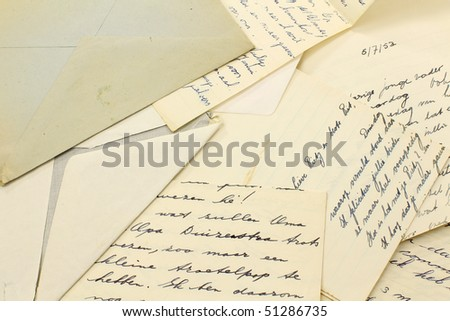old letters and a grungy envelope - stock photo