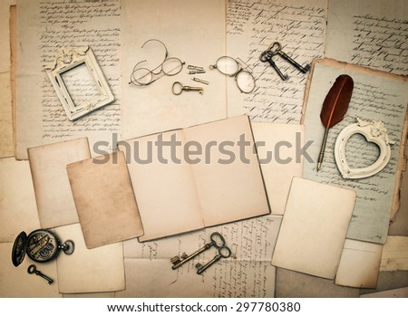 Old letters and photo frames. Vintage things, handwritten documents, open book. Nostalgic sentimental paper background - stock photo