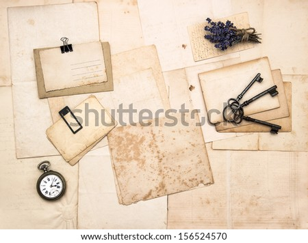 old letters and photos, vintage accessories, keys, clock, flowers. nostalgic sentimental paper background - stock photo