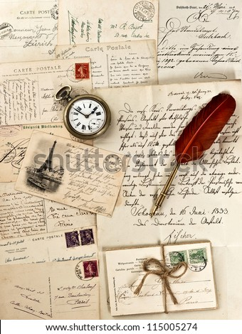 old letters and post cards with feather quill and vintage clock. nostalgic background