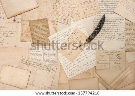 old letters, vintage postcards and antique feather pen. nostalgic sentimental background - stock photo