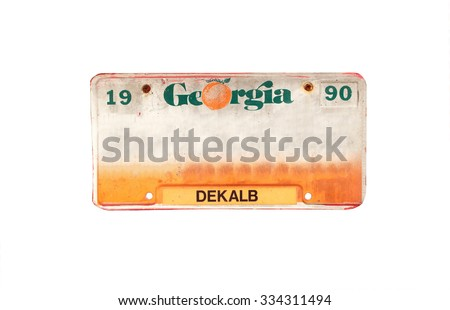 Old license plate of Dekalb, Georgia, America on isolated white background. - stock photo