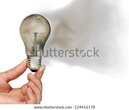 Old light bulb burned inside and smoke - stock photo