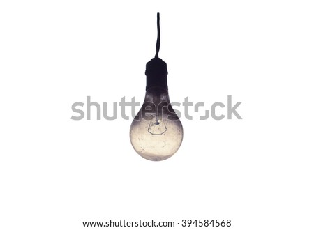 Old light bulb isolated on white background. - stock photo