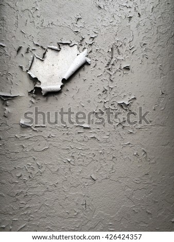 Old light grey painted wall background. cracked wall.