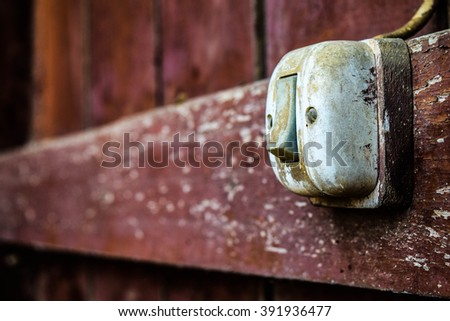 Old light switch on old wood texture backgrounds