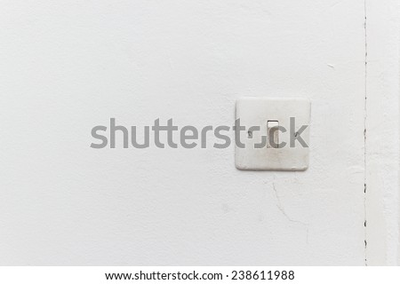 old light switch on the white wall - stock photo