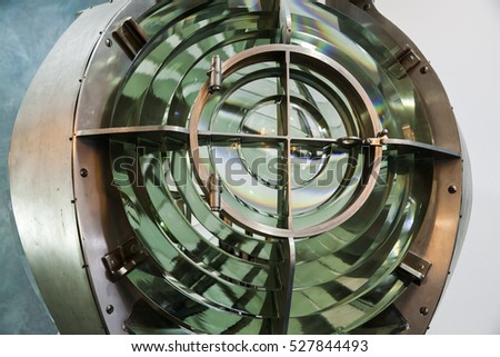 Old Lighthouse lamp with lens made of glass rings. Closeup photo with selective focus