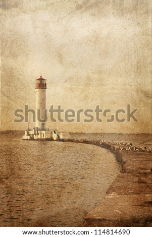 Old lighthouse. Photo in vintage image style. - stock photo