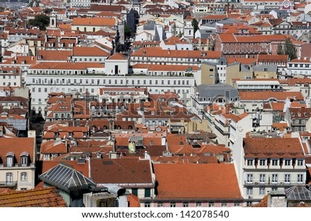 Old Lisbon rooftops - stock photo