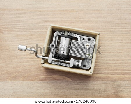 Old little music box on a wooden background. - stock photo