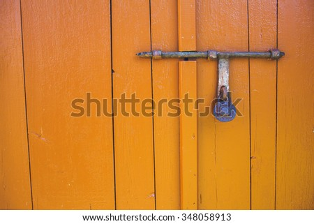 old lock and Rusty padlock on an old wooden door with vintage style