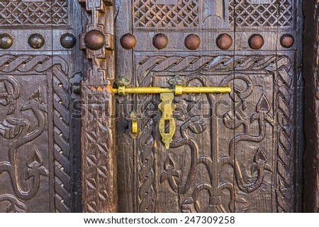 old lock on a wooden carved door